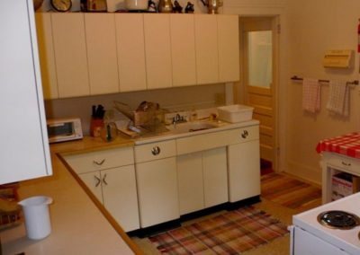Roomy, full kitchen — bright, clean, functional and fun!