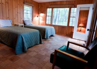 The side cabin, two single beds or a king. includes and bathroom+ shower stall.