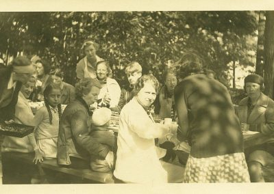 1932. My family enjoying lunch on Lost Lake. My mother, in pigtails.